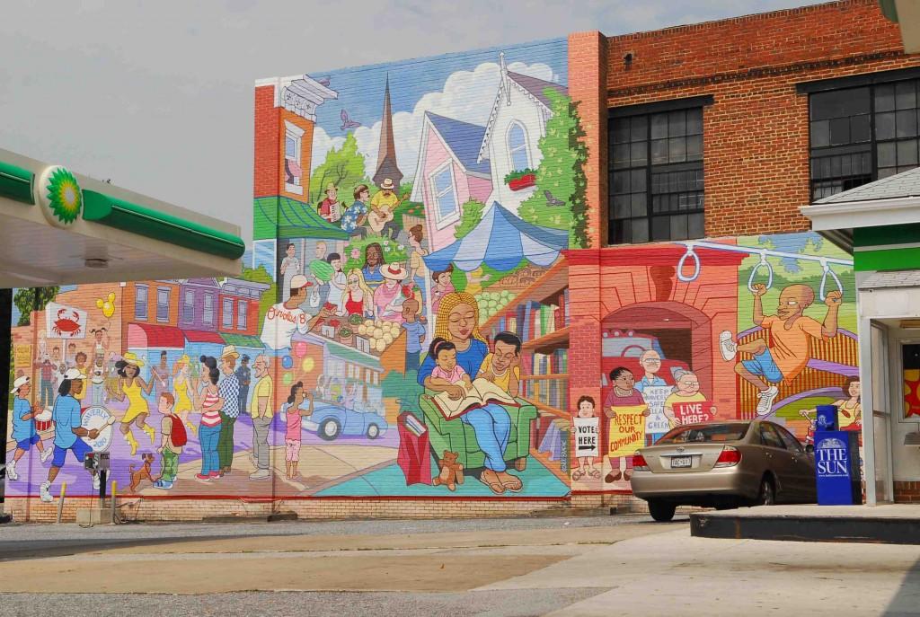 4. Mural de Tom Chalkley (3313 Greenmount Avenue), 2010. (http://www.baltimoresun.com/entertainment/bal-baltimores-50-coolest-murals-pictures-20120807,0,4770287.photogallery). L'artiste insiste sur l'esprit de quartier qui règne dans une rue animée par une population multi ethnique qui se retrouve au marché pour consommer les produits agricoles des jardins communautaires; il fait référence aux symboles culturels traditionnels de Baltimore: le crabe de la baie de Chesapeake, l'équipe de base-ball des Orioles. L'implication civique et l'empowerment passent aussi pas la participation électorale).