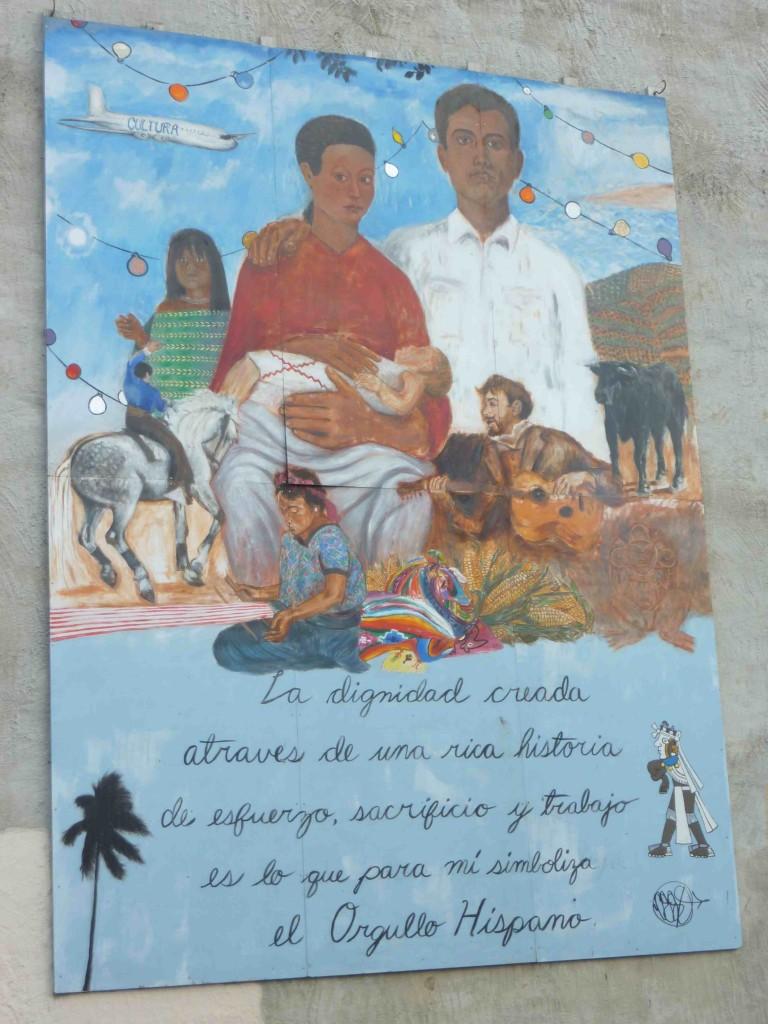 Mural de Eric Monastario (412 South Broadway), 2000. Photographie prise en avril 2012, S. Baffico. « La dignidad creada atraves de una rica historia de esfuerzo, sacrificio y trabajo es lo que para mi simboliza el orgullo hispano ». L'artiste met ici en valeur les épreuves et les efforts d'intégration des immigrés hispaniques installés principalement dans les quartiers de Fells Point et de Highlandtown.